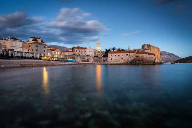 Budva's old town and beach during sunset