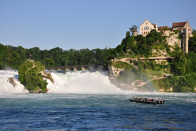 Austria Marvel at the biggest waterfall in Europe on Day 5 of our Lake Constance Cycling holiday. Located in mediaeval Stein am Rhein is the tumbling Rheinfall waterfall, above which a tiny castle (Schloss Laufen) perches precariously.