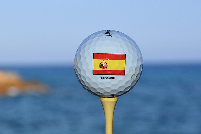 Spain branded golf ball on the coast of Catalunya.