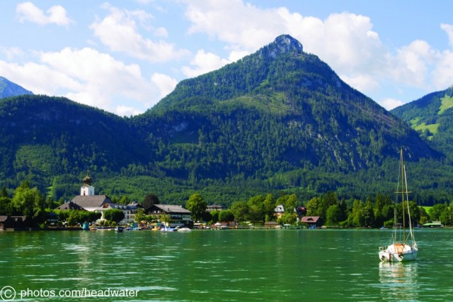 Lake side view of Strobl in rural Austria at the foot of a mountain