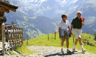Couple walking in Switzerland - Headwater