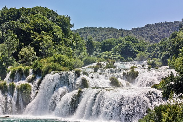 Croatia There is a myriad of lakes and waterfalls at Krka National Park on Day 7 of our guided Delights of the Dalmatian Coast Walk. After a picnic, we'll explore the tiers of ponds bright with yellow water lilies that shimmer below the mighty Skradinski waterfall.
