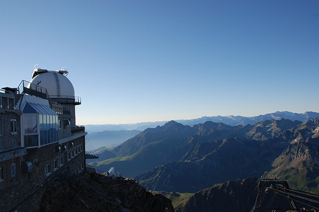 The observatory and view from the Pic du Midi. Photo: Elfinou | Adobe Stock